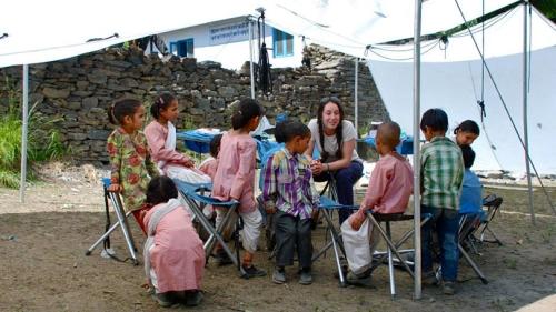 Sydney Kamen leading a handwashing workshop with a group of children
