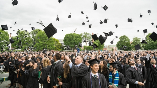 Students celebrate at the end of the commencement ceremony.