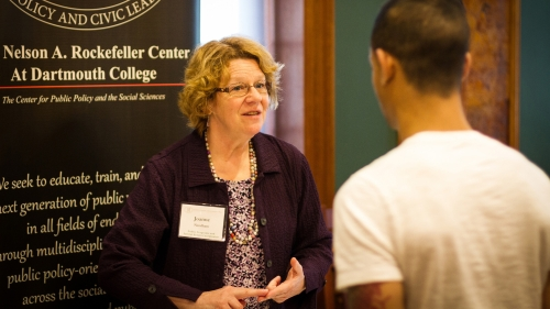 Joanna Needham speaks with a student about the Rockefeller Center at the spring job fair
