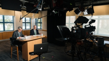Photograph showing President Hanlon and Provost Helble during a community conversations webcast